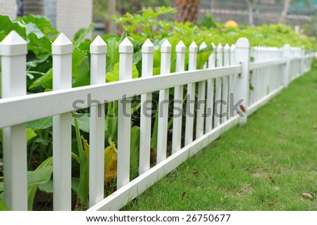 White picket fence and flower bed