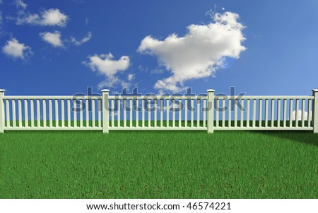 White picket fence on perfect lawn - stock photo