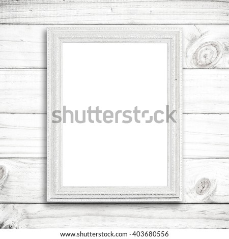 White picture frame on white wood wall. - stock photo