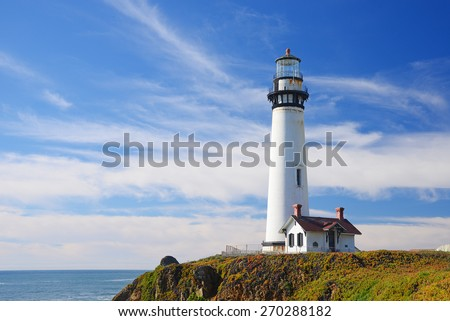 white pigeon point lighthouse with a blue sky in a sunny day - stock photo
