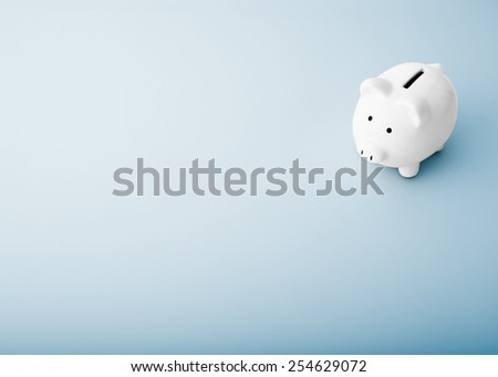 white piggy bank on a blue background - stock photo