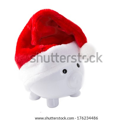 White piggy bank with a Christmas hat and destined for paying Christmas expenses - stock photo