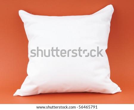 white pillow on an orange background - stock photo