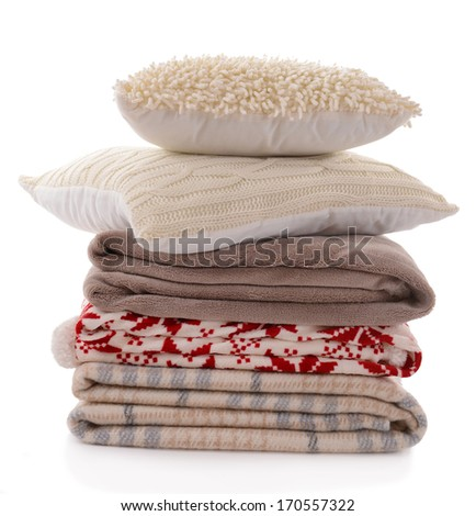 White pillows and colorful plaids isolated on white - stock photo