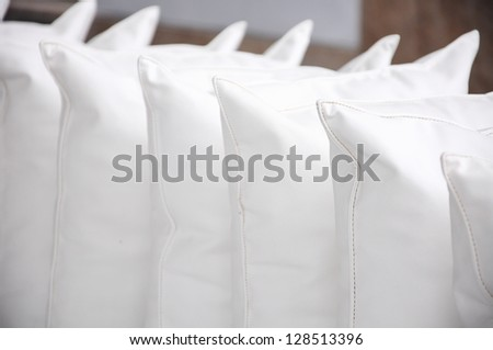 white pillows leather on cushion - stock photo