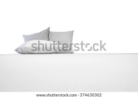 White pillows on white bed, isolated on white background - stock photo