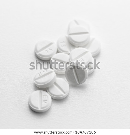 white pills drugs Tablets doctor flu antibiotic pharmacy medicine medical therapy - stock photo