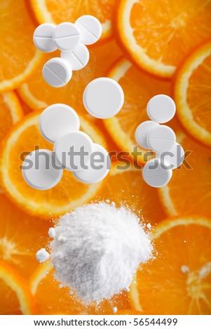 white pills with oranges - stock photo