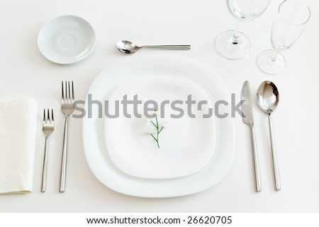 white place setting with little flower - stock photo