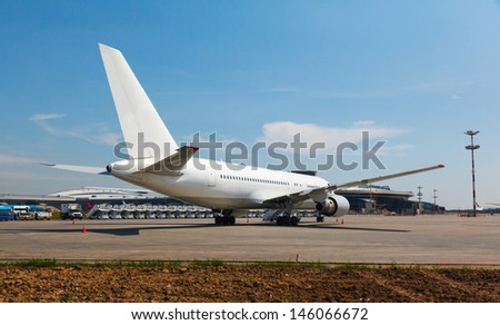 white plane on the platform airport in the sun in summer - stock photo