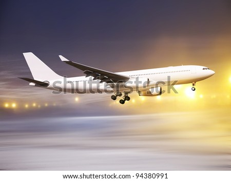 white plane taking off at non-flying weather, blowing snow - stock photo