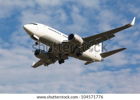 white plane with gear against blue sky