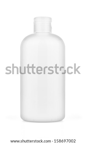 White plastic bottle with spray on white background. - stock photo