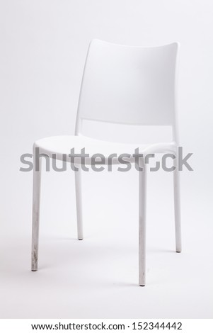 white plastic chair on isolated - stock photo