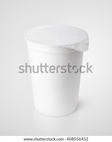 White plastic container for dairy foods with foil lid on gray