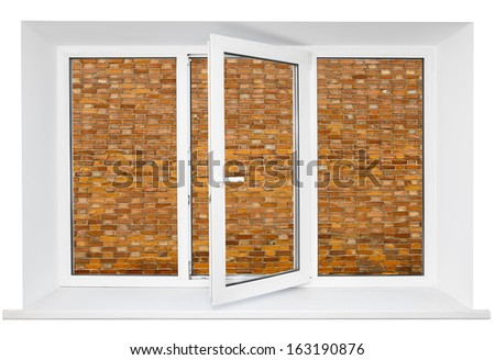 White plastic cutout triple door window with brick wall inside - stock photo