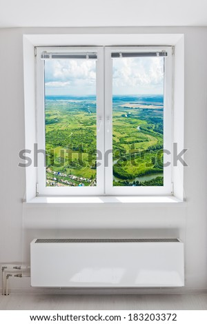 White plastic double door window with radiator under it. Domestic room.  - stock photo