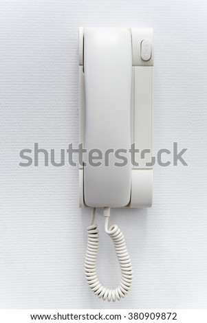 white plastic house intercom on the wall - stock photo