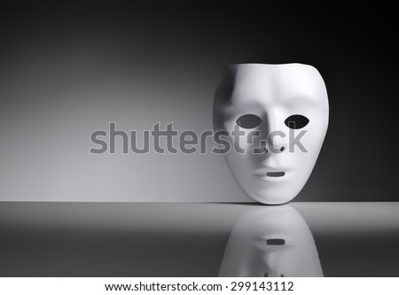 White plastic mask on reflective surface. - stock photo