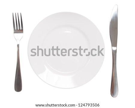 White plate and silver utensil - stock photo