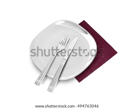 White plate, fork and knife on brown napkin. Isolated on white. With clipping path