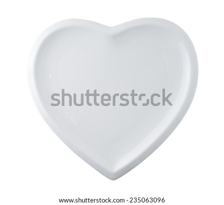 white plate in shape of heart isolated on white - stock photo