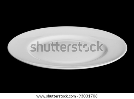 White plate isolated on black - stock photo