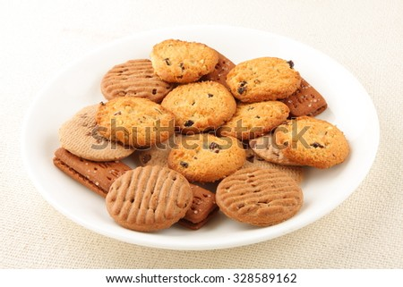 White plate of  homemade cookies and biscuits.