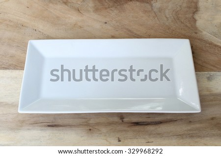 white plate on the table - stock photo