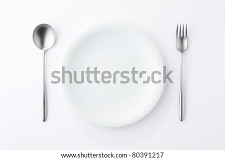 white plate , Spoon and fork on white background. - stock photo