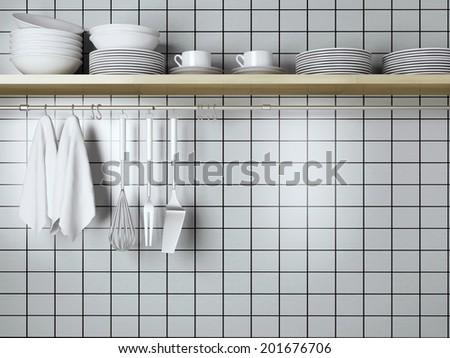 White plates on the wooden shelf, kitchen cooking utensils. Steel spatulas, whisk and towel in front of wall.  - stock photo