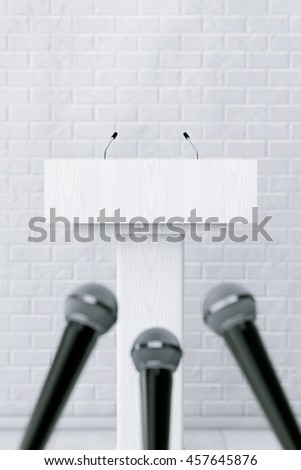 White Podium Tribune Rostrum Stand with Microphones in front of Brick Wall. 3d Rendering - stock photo