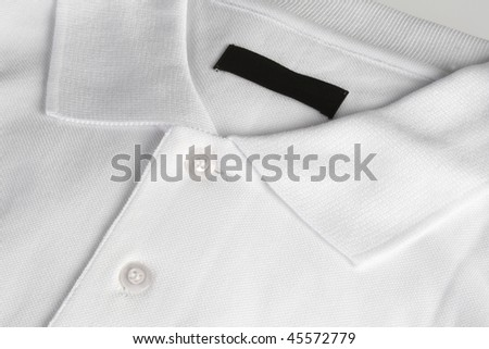 White poloshirt with blank black label - stock photo