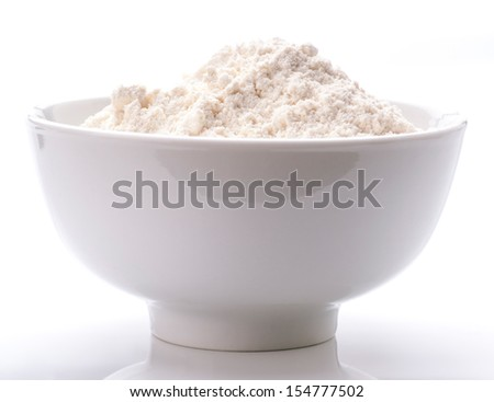 white porcelain bowl filled with flour