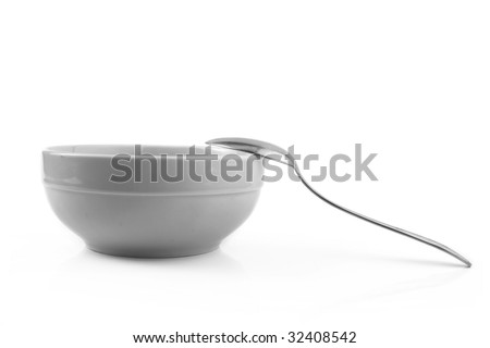 white porcelain bowl with a spoon isolation on a white background - stock photo