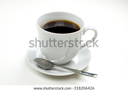 White porcelain cup of coffee. White background.
