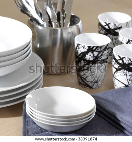 White porcelain with glasses and cutlery - stock photo