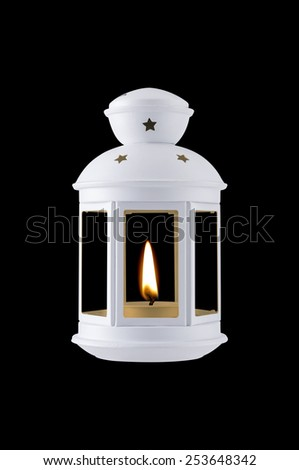 White portable lamp with retro design and little flame turn on - stock photo