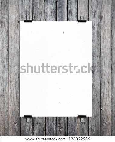 white poster on a wood wall - stock photo