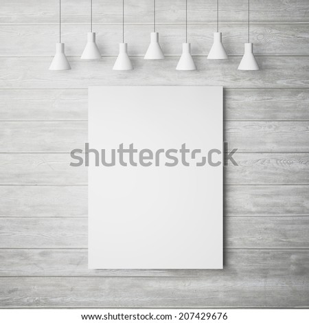 White poster on a wood wall with lamps - stock photo