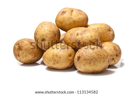 White Potatoes isolated on a white studio background.