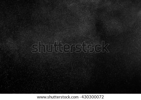 White powder explosion on black background. Abstract white dust texture.