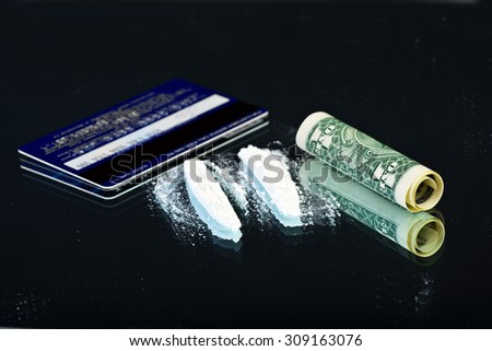 White powder on mirror with dollar bill and card - stock photo