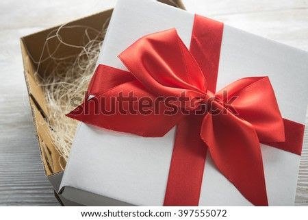 white present box with red ribbon bow