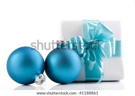 White present wrapped with sky blue ribbons and ornaments