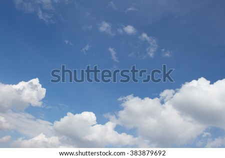 White puffy clouds on the background blue sky