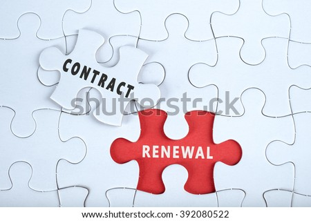 White puzzle with the word CONTRACT & RENEWAL, contract management conceptual - stock photo