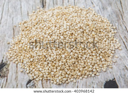 White quinoa grain over wooden background