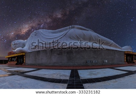 White reclining  buddha under starry night with clearly  milky way  , Thailand - stock photo