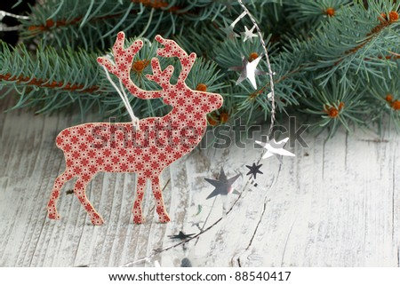 White-red christmas deer with a christmas tree and silver stars - stock photo